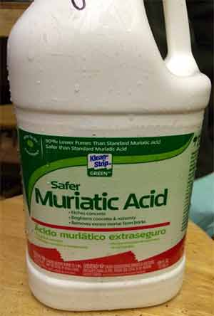 Mix up Muriatic acid and baking soda solution